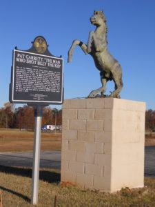 Pat Garrett Monument Cusetta, Alabama. Horse standing on concrete block.