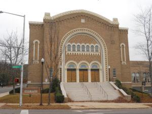 Temple Beth-El Birmingham Alabama. Brown tinted brick building with wide, stone stairway at entrance.