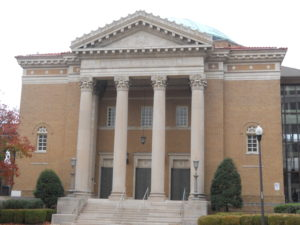 Southern Synagogues: Temple Emanu-El Birmingham Alabama. Brown tinted brick building with four two-story pillars.