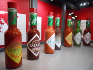 Tabasco Museum and Factory Tour Avery Island Louisiana. Seven ten foot tall bottles of Tabasco Sauce.