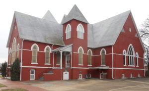 First Baptist Church Selma, Alabama. Brick church with long roof line.
