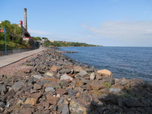 Boardwalk along Lake Superior Duluth, Minnesota. Walking path and rocks along coastline.