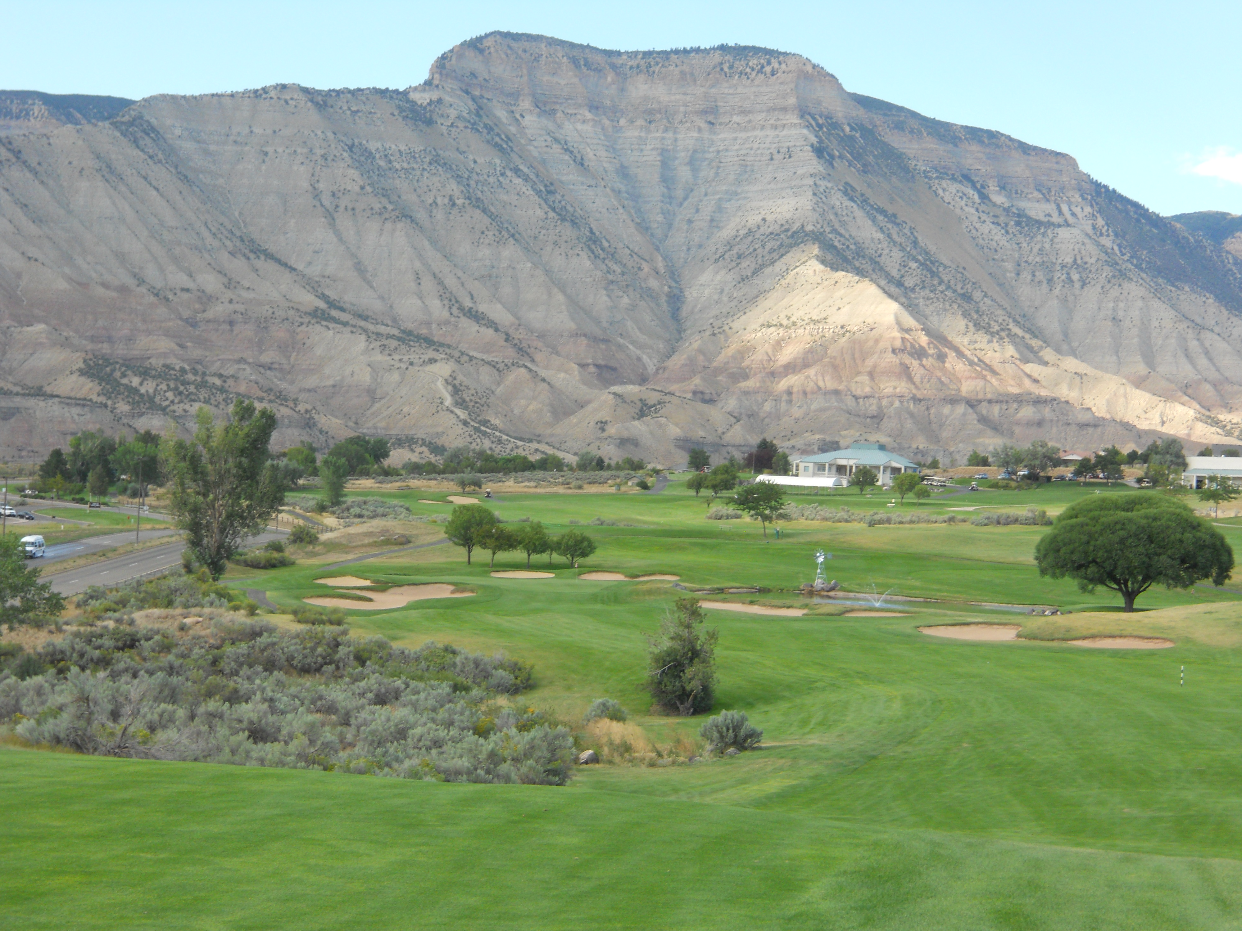 Battlement Mesa Golf Club Parachute, Colorado. Landscape of golf course in front of huge mountain.